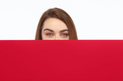 Girl hiding behind cardboard Royalty Free Stock Images
