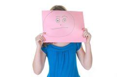 Girl hiding behind fake face - emotional series. Girl hiding behind happy face, part of emotinal series Stock Images