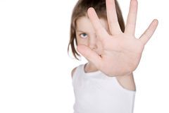 Girl Hiding Behind her Hand Royalty Free Stock Images