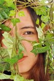Girl Hiding Behind Ivy Stock Photo