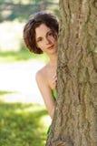 Girl hiding behind tree Royalty Free Stock Image