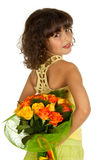 Girl hiding flowers. Little girl hiding flowers for mother's day Royalty Free Stock Photography