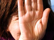Girl hiding her face with her hand Royalty Free Stock Photos