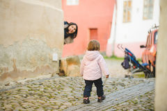 Girl and Hiding Mother Royalty Free Stock Photos
