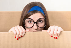 Girl hiding in the moving box Royalty Free Stock Photos