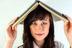 Girl hiding under book Stock Image