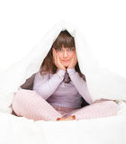 Girl hiding under cover Royalty Free Stock Image