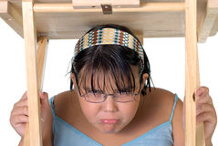 Girl Hiding Under Table royalty free stock image