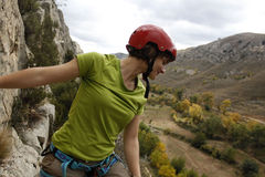 Girl high doing a via ferrata Royalty Free Stock Photos
