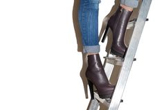 The girl in the high-heeled shoes. The girl on the stairs. The girl in the shoes with high heels stock photo