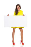 Girl In High Heels Holding Placard Royalty Free Stock Photos