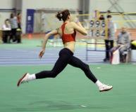 Girl on the high jump Royalty Free Stock Photos