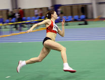 Girl on the high jump Stock Image