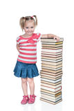Girl at a high pile of books Stock Images