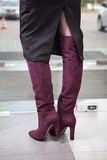 Girl in high red boots, a coat in the office Royalty Free Stock Photos