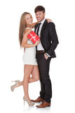 Girl in high shoes holds gift Stock Photography