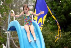 Girl High Up on Pool Slide Royalty Free Stock Photos
