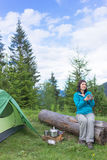 Girl in hike with a tent in the mountains in summer Stock Image