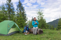 Girl in hike with a tent in the mountains in summer Royalty Free Stock Photos