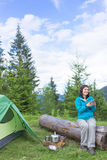 Girl in hike with a tent in the mountains in summer Stock Photography