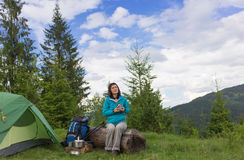 Girl in hike with a tent in the mountains in summer Stock Images