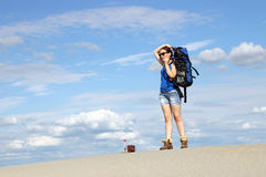 Girl hiker with a backpack Stock Images