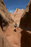 Girl Hiker Backpacker in the Slot Canyon Royalty Free Stock Photography