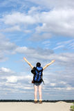 Girl hiker with hands up Royalty Free Stock Image