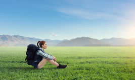 Girl hiker having rest. Mixed media Royalty Free Stock Photos
