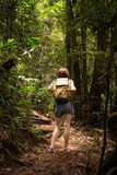 Girl hiker at the jungle forest Stock Images