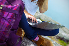 Girl hiker with a laptop Stock Photography