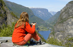 Girl hiker looking at the fjord Stock Photos