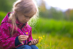 Girl hiker on a meadow Stock Images