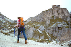 Girl hiker at the mountains Dolomites Royalty Free Stock Photography