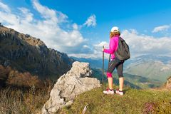 Girl hiker rests in the mountains Stock Photography