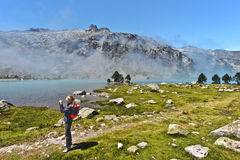Girl hiker taking picture from Aubert lake border Royalty Free Stock Photos