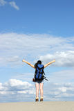 Girl hiker with thumbs up in desert Stock Photo
