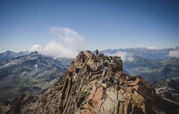 Girl hiking along the mountain ridge, few meters before the Quintino Sella refuge, Italian Alps. Stock Photography