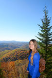 Girl hiking in autumn mountains. Royalty Free Stock Images