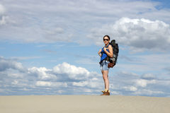 Girl hiking in desert Royalty Free Stock Photos