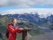 Girl hiking having fun and enjoying wonderful breathtaking volcanic mountain view. Freedom concept. Iceland royalty free stock photo
