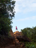 Girl hiking Kalalau trail in Kauai Royalty Free Stock Photo