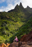 Girl hiking Kalalau trail in Kauai Stock Image