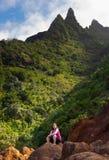 Girl hiking Kalalau trail in Kauai stock image