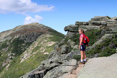 Girl hiking in mountains. Girl with rucksack hiking in White Mountains of New Hampshire, U.S.A Royalty Free Stock Images