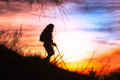 Girl hiking in silhouette Stock Photography