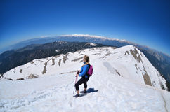Girl  hiking .Snow on the top of the Tahtali mountain , Turkey. Girl  hiking .Snow on the top of the Tahtali mountain in Turkey Royalty Free Stock Photo