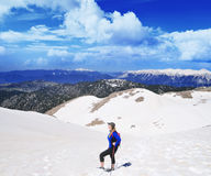 Girl  hiking .Snow on the top of the Tahtali mountain Royalty Free Stock Photography