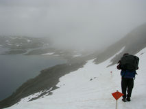 Girl hiking in snowfield and fog Stock Photo