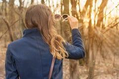 Girl on hiking trip enjoying the sun Royalty Free Stock Images